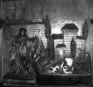 Talla del escultor Castro Canseco el la sillería del monasterio deCelanova,representando el pedrón y la capilla de san Miguel, hacia 1717